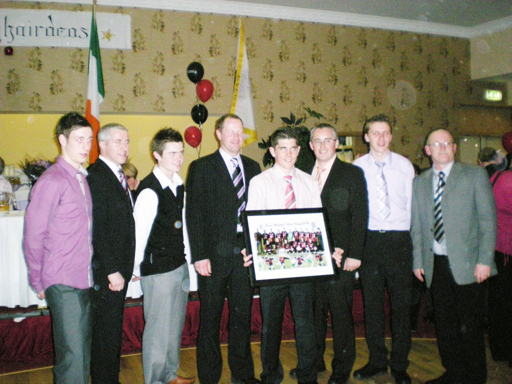 erris united football club  ronan receiving his presentation from the club l r thomas duffy stephen carolan